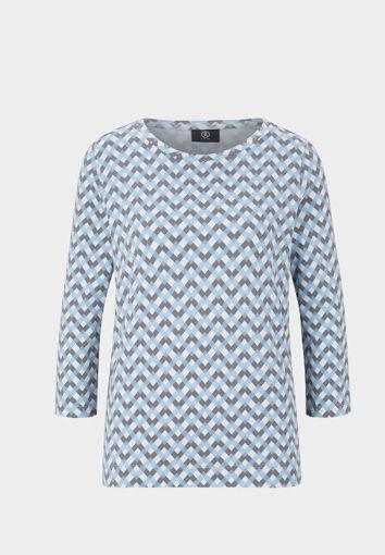 Tshirt in cotone elasticizzato con disegni optical nel colore azzuro e grigio su base bianca.
